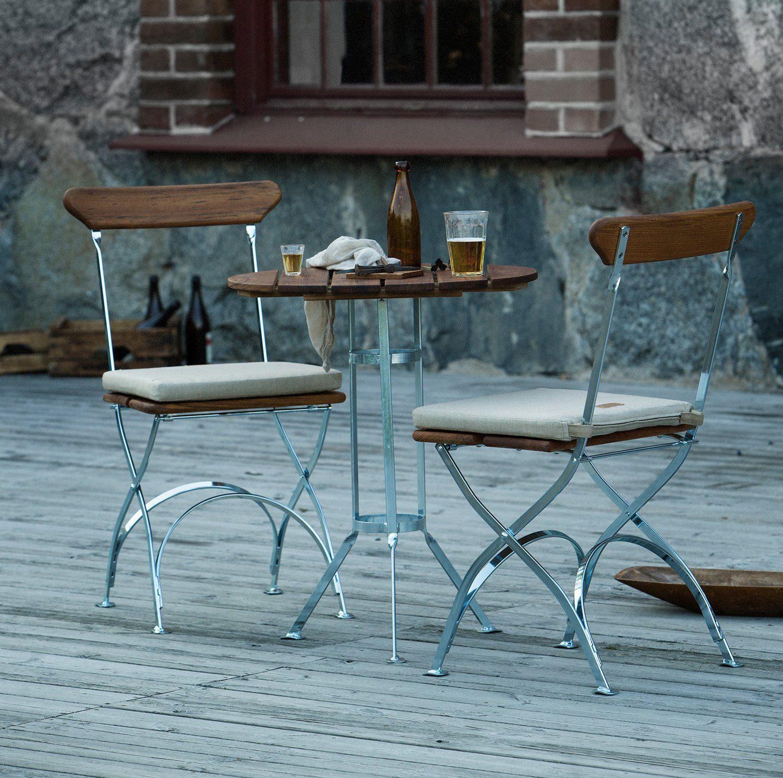 Bryggeristolar och bord i teak från Grythyttan Stålmöbler.