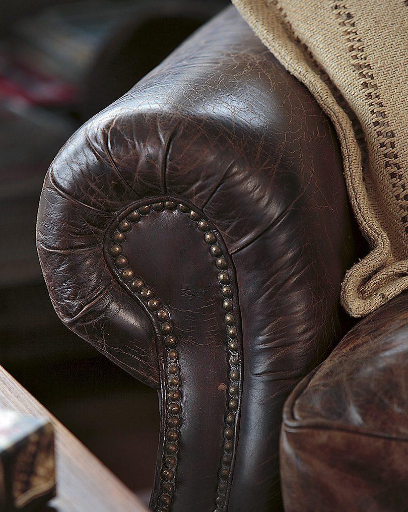 Detaljbild på Kensington fåtölj i leather vintage cigar.