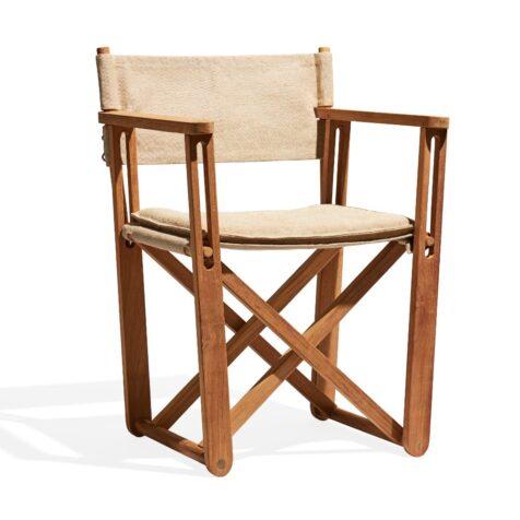 På Kryss stol i teak och canvas.