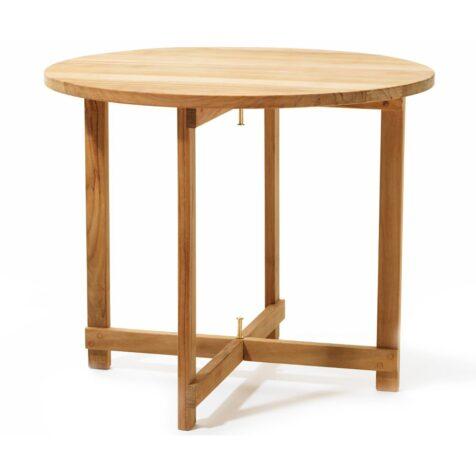 På Kryss bord i teak.
