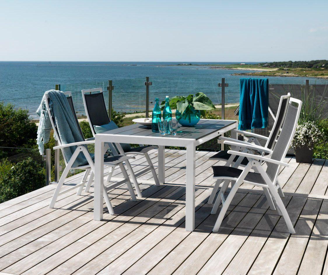 Sunny positionsstol tillsammans med Crescendo matbord.