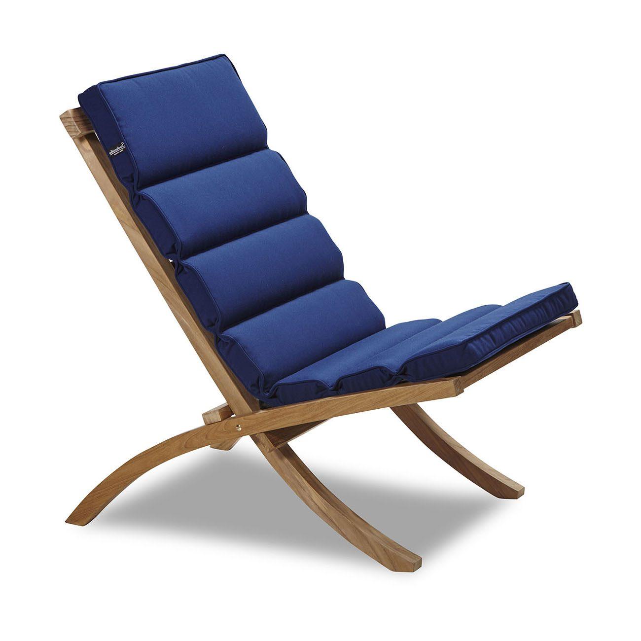 En blå dyna i Musko stol från Stockamöllan.
