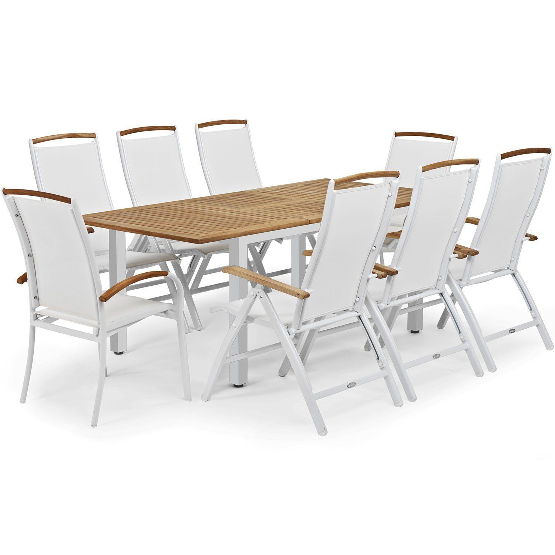 Nydala matgrupp i vitt och teak med förlängningsbord och positionsstolar.