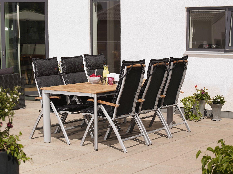 Nydala matgrupp med positionsstol i teak och silverfärgad aluminium.