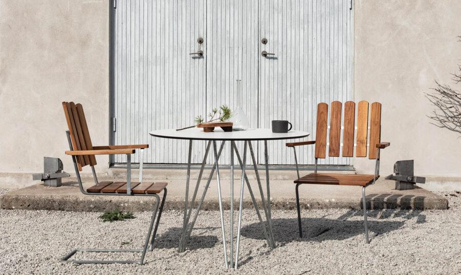 Bild på A2 fåtölj i teak med High-Tech bord.