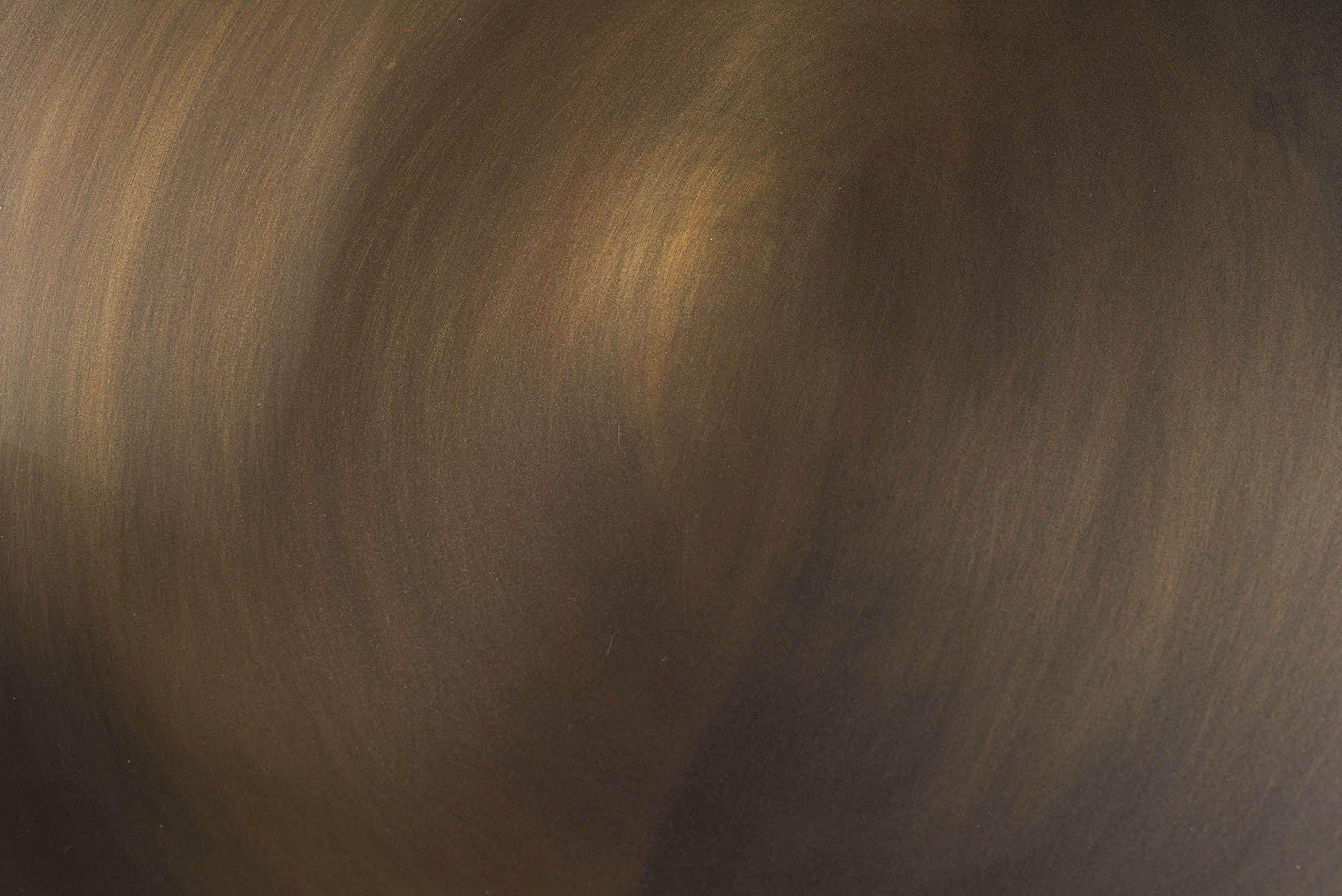 Detaljbild på Fredo bordsskiva i borstad stål.