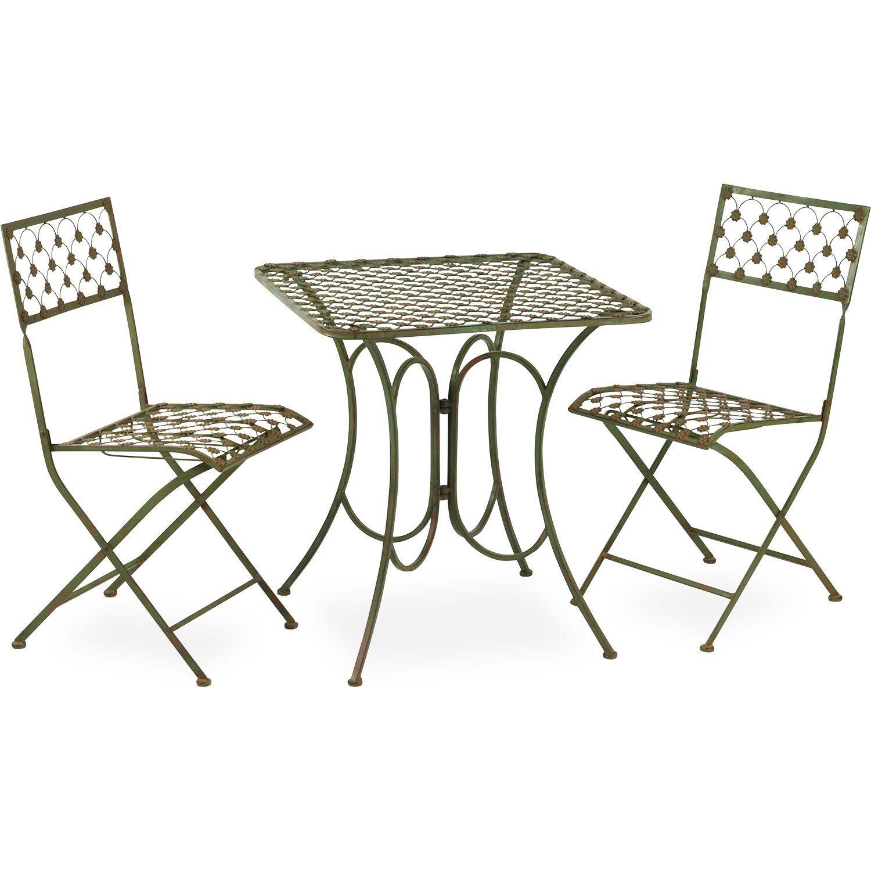 Smidesstolar och smidesbord från By Boysen i antikgrönt.