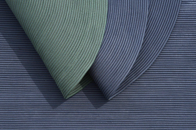 Infinty mattor från Cane-Line i blått och grönt.