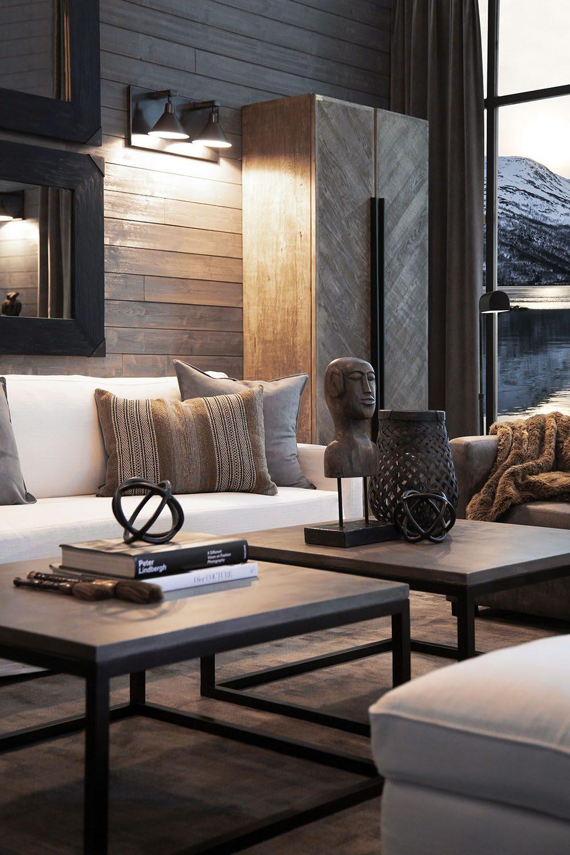 Miljöbild på soffan guilford i 4-sits med soffbord i betong med stålstativ.