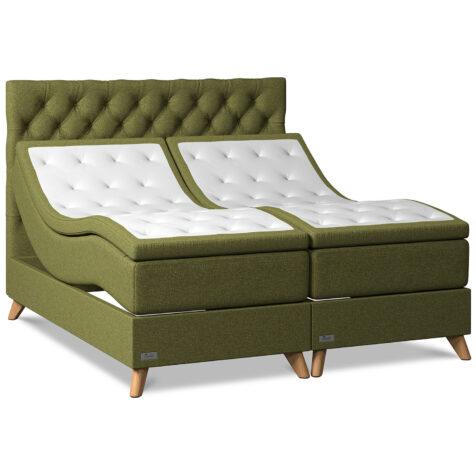 Elegans ställbara sängar i färgen mossa med lutande ben i rökt ask.