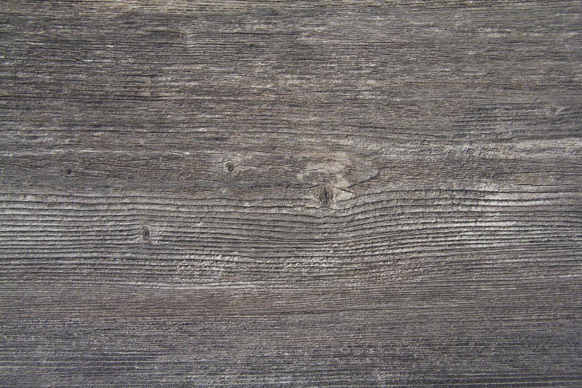Laminatskiva i färgen rustik grå.