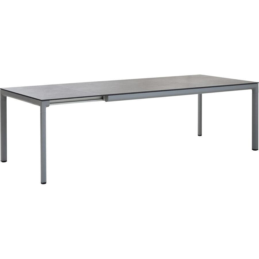 Drop förlängningsbord i ljusgrått med svart bordsskiva.