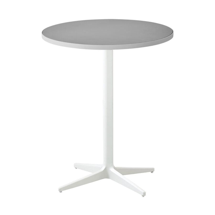 Cafébordet Drop i vitt med bordsskiva i ljusgrå keramik.