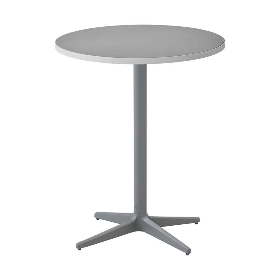 Cafébordet Drop i ljusgrått med bordsskiva i ljusgrå keramik.