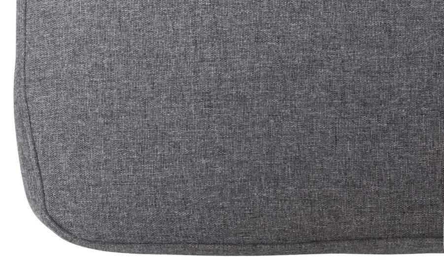 Detaljbild på grå melange polyesterdyna.