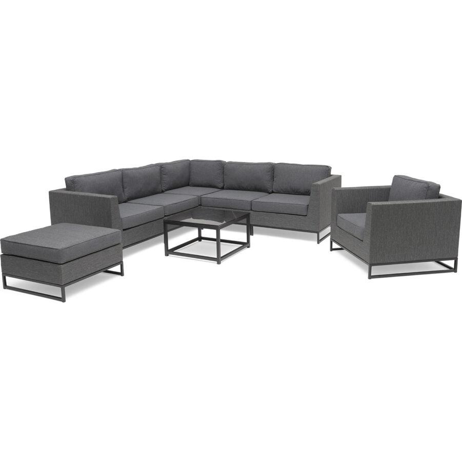 Bild på soffan Adelshamn i grå textilene med soffbord på Hillerstorp.