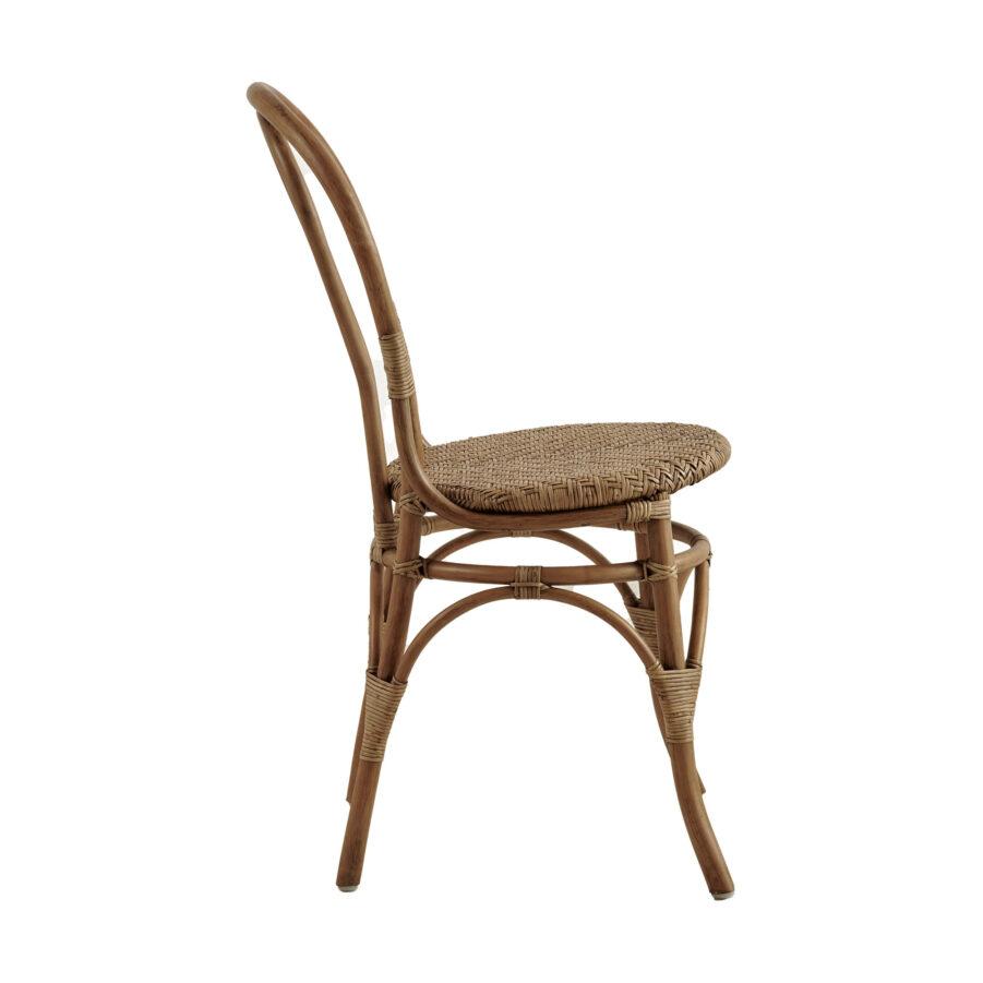 Bild från sidan på Lulu rottingstol i färgen antik.
