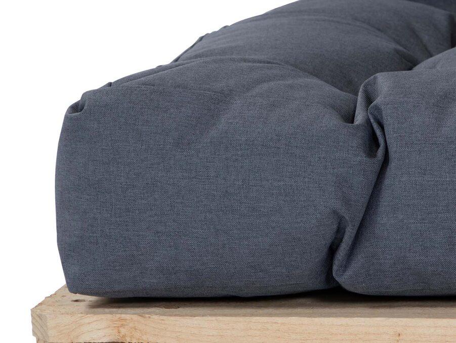 Detaljbild på Enris soffdyna i grått.