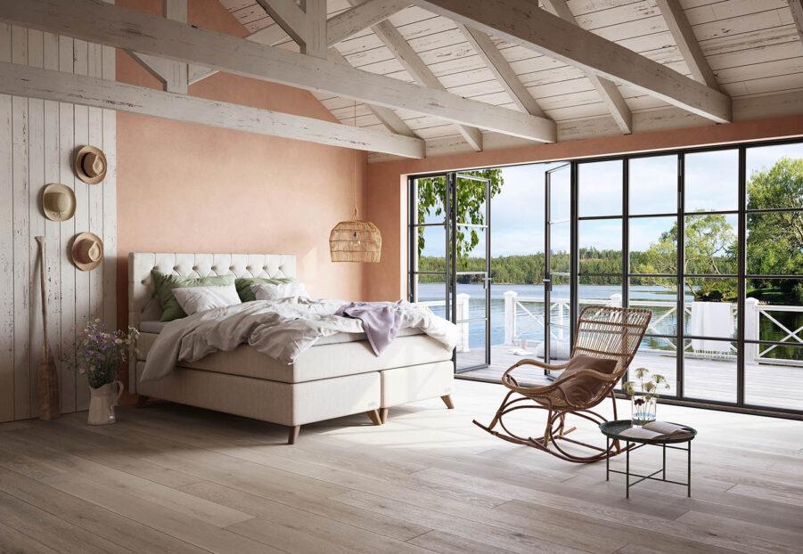 Miljöbild på Ekens Elegans säng med Djupknappad gavel och manchestertyg.