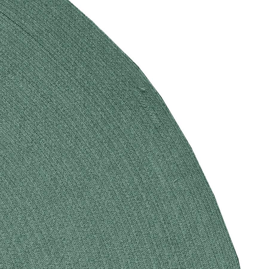 Detaljbild på Circle matta i mörkgrönt.