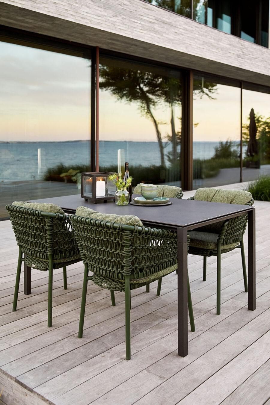 Miljöbild på Ocean matgrupp med gröna stolar.