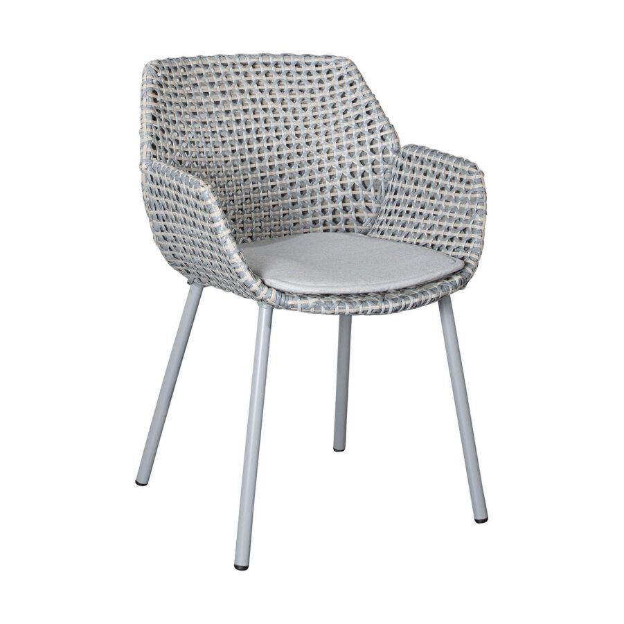 Vibe karmstol i ljusgrått med dyna.